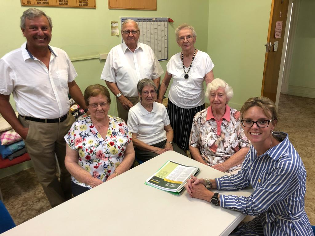 Steph Cooke sits around a table with members of the Temora Senior Citizens Club.