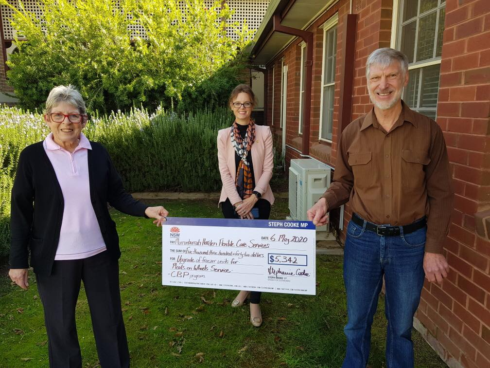 Deb and Stewart hold a novelty cheque between them with Steph Cooke standing behind. All three look at the camera and smile.