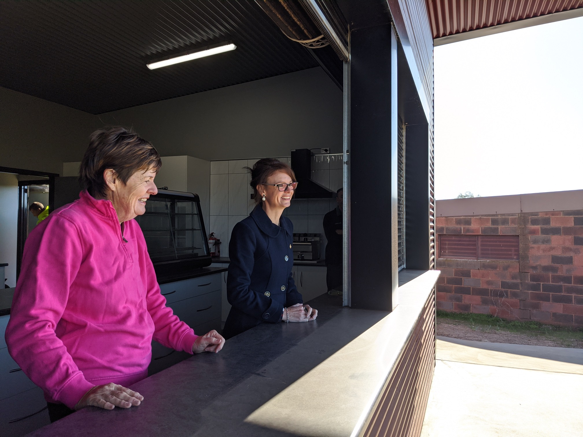 Vicki Langtry and Steph Cooke look out of the canteen window at the Marrar Football Club house.