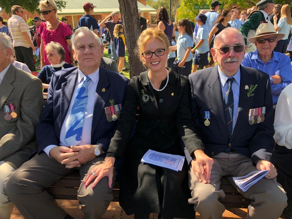 Steph Cooke sits with veterans on Anzac Day.
