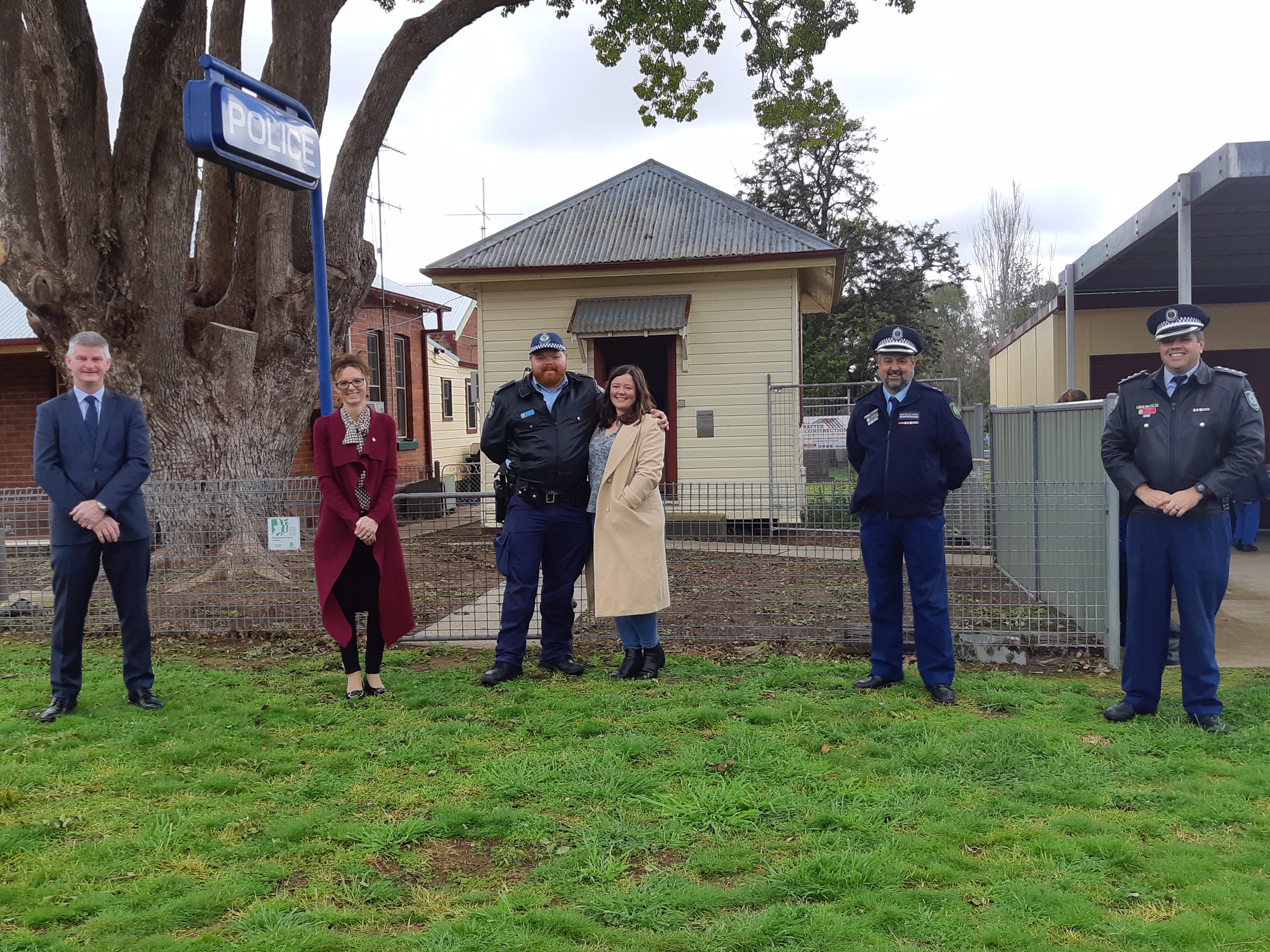 Hilltops Mayor Cr Brian Ingram, Steph Cooke MP, Senior Constable Andrew Campbell and his partner Savannah Sissons, acting Hume Commander Superintendent Condon and Inspector Reeves stand in front of the Koorawatha Police Station.