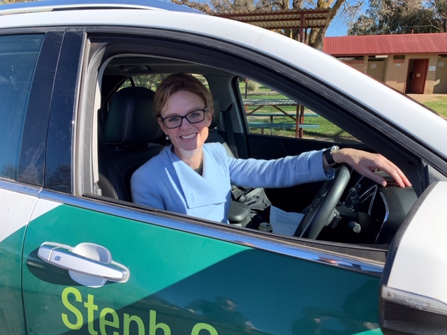 Steph Cooke sits in a car with her name branded on it in stickers.