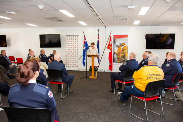 Steph Cooke speaks from a podium to a crowd of emergency services workers, Minister David Elliott and guests at the opening of the South West Slopes Fire Control Centre.