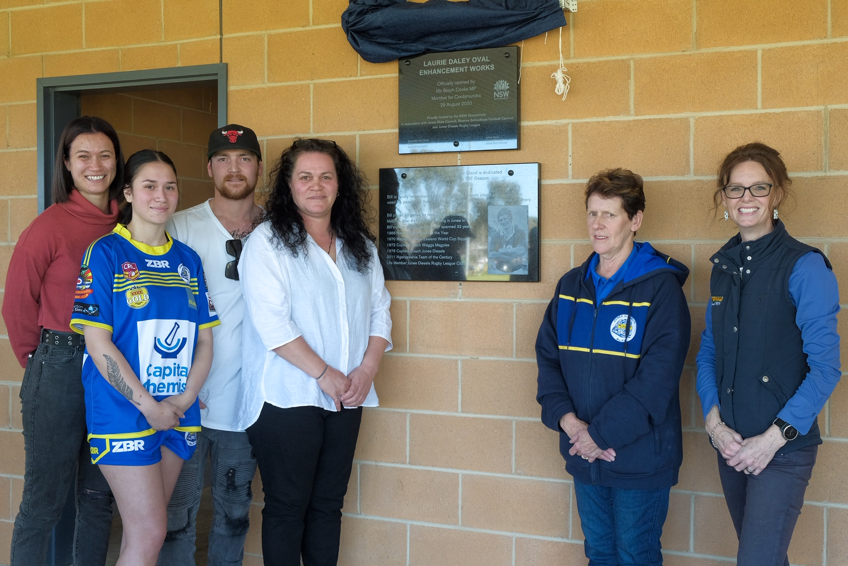 Billie Deacon, Maddy Deacon, Matt Logan, Lyandra Logan, Noreen Deacon and Steph Cooke MP in front of a brand new plaque on the new amenities building.
