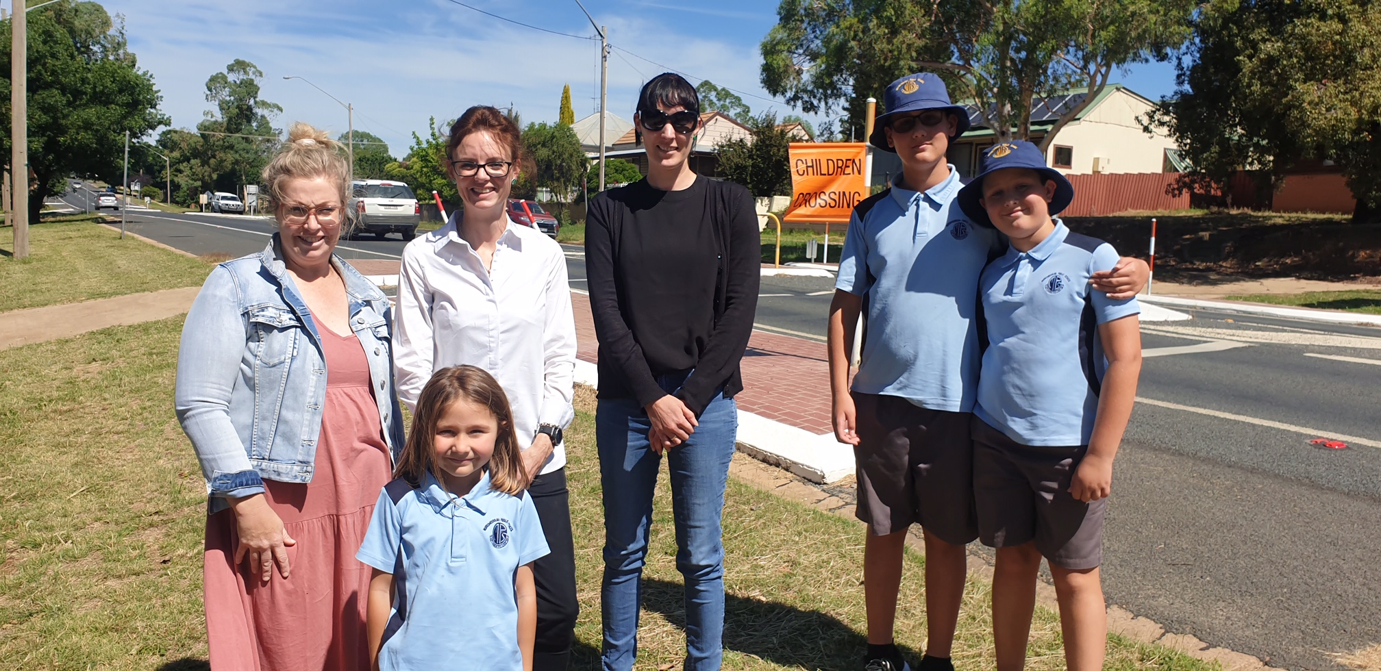 Renee Ford, Ana Djukic, Steph Cooke MP, Carrie Giddings, David and Marko Djukic stand in front of a school crossing.