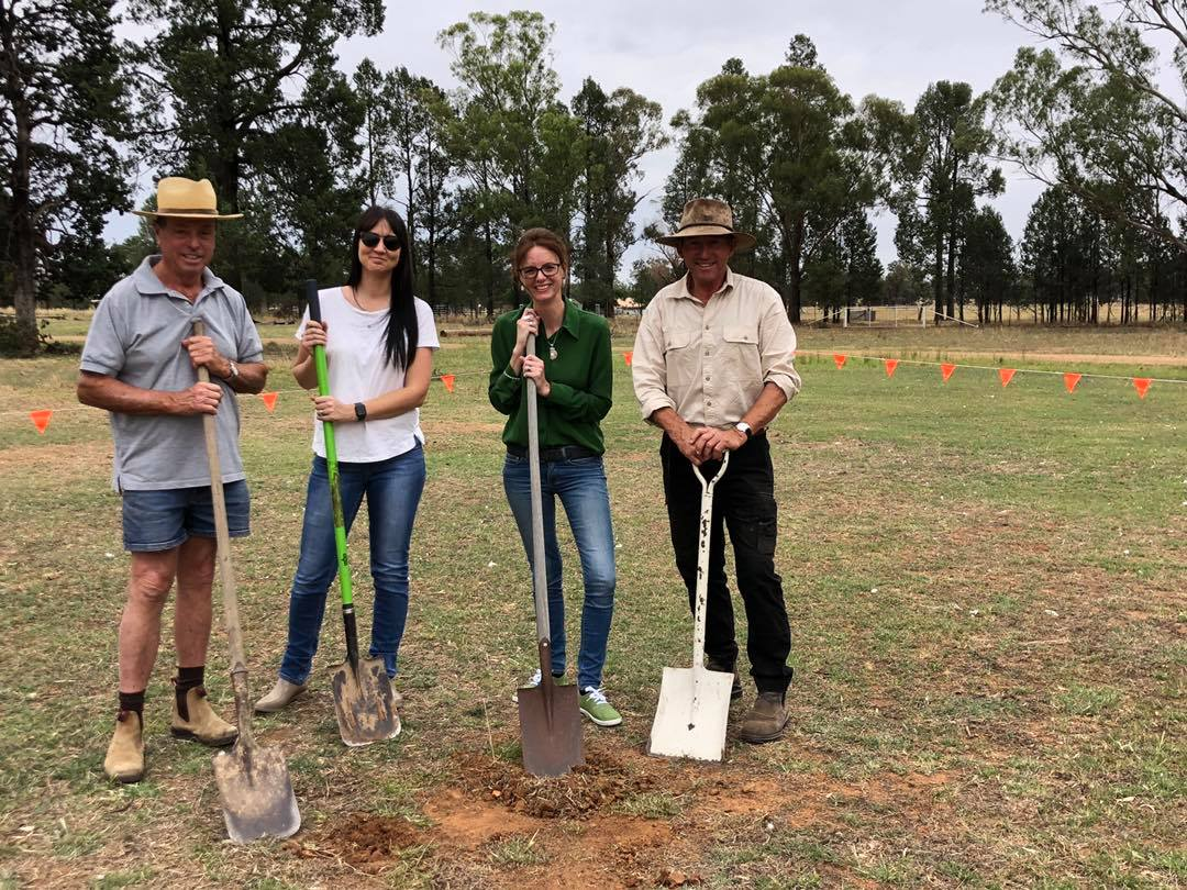 Bill West, Emma Whitechurch, Steph Cooke MP and Michael Hunter lean on shovels that have scraped in to the earth.