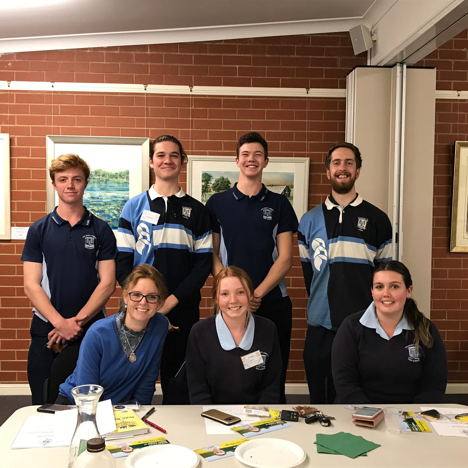 Member for Cootamundra Steph Cooke is surrounded by four teenage boys and two teen girls in school uniforms.