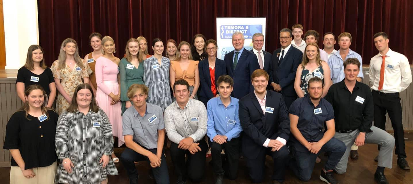 Steph Cooke MP, Michael McCormack and Rick Firman are surrounded by young people.