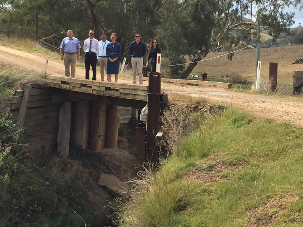 Mayor Abb McAlister, GM Phil McMurray, Zubee Hossain, Steph Cooke MP, Matt Stubbs, Belle Mooney stand on one of the bridges to be replaced.