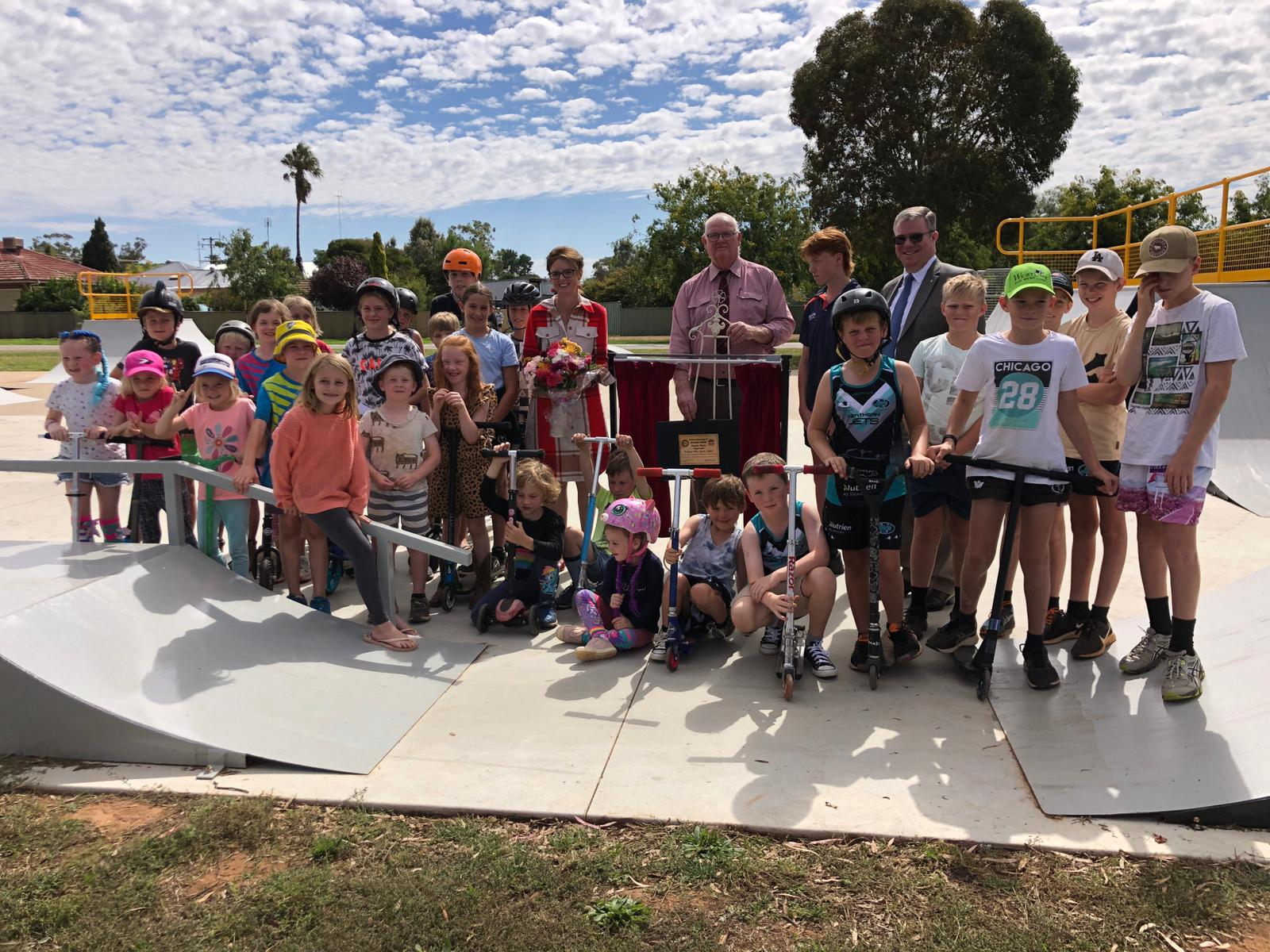 Steph Cooke stands with skaters and council at the new skate park.