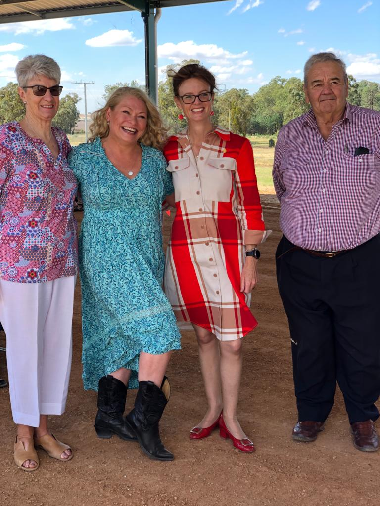 Margaret Seymour, Gayle O'Neil, Steph Cooke MP and John Seymour stand close together and smile at the camera.