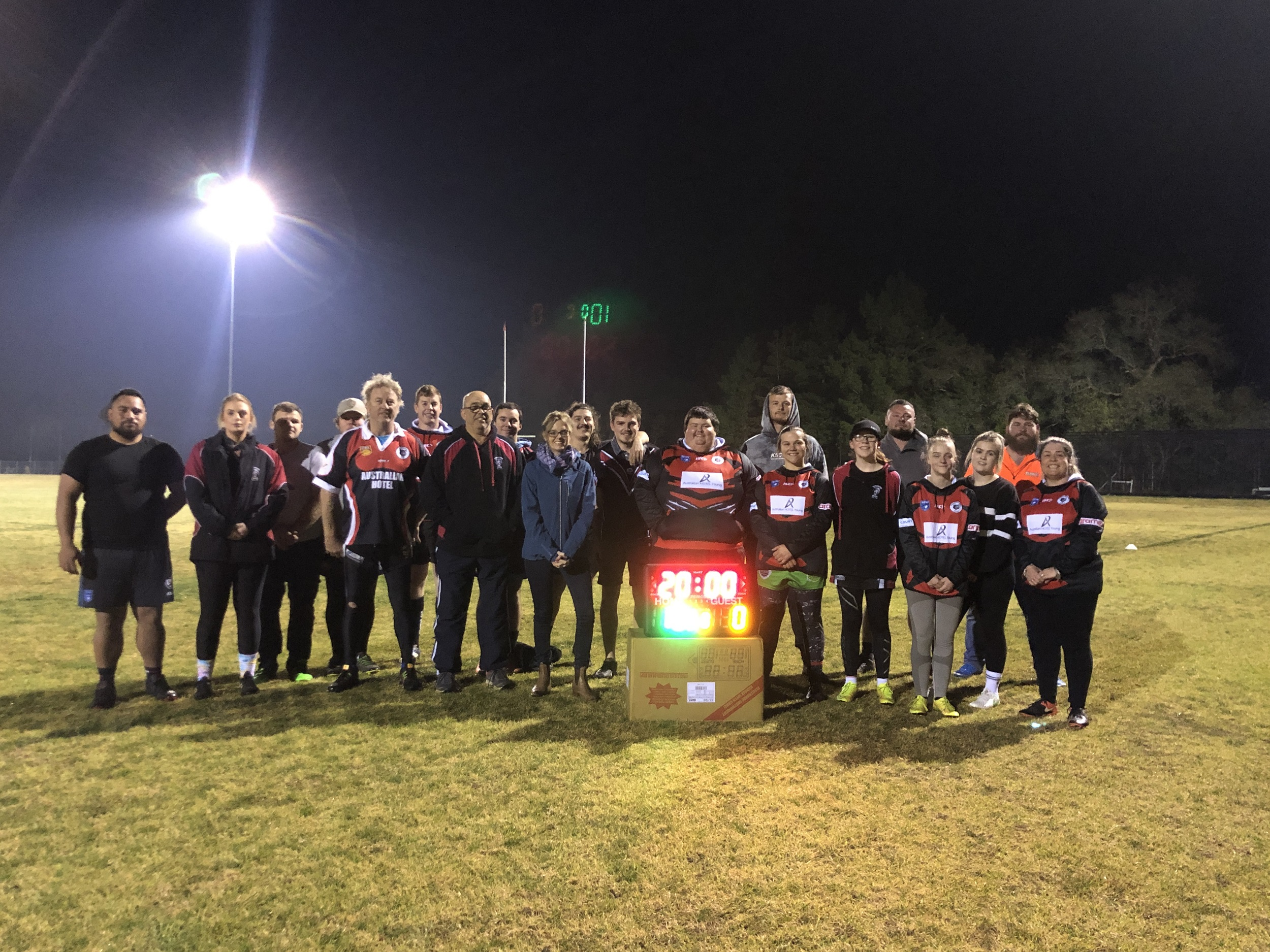 Steph Cooke MP with members of the Burrangong Bears RLFC and the new portable score board.